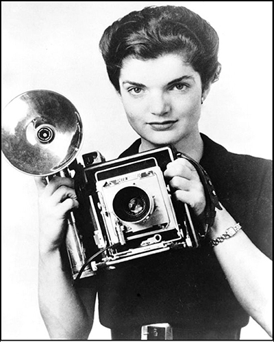 Jacqueline Bouvier with a Speed Graphic Press Camera circa 1952.